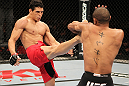 BELO HORIZONTE, BRAZIL - JUNE 23: (R-L) Cezar Ferreira kicks Sergio Moraes during their UFC 147 middleweight bout at Estádio Jornalista Felipe Drummond on June 23, 2012 in Belo Horizonte, Brazil. (Photo by Josh Hedges/Zuffa LLC/Zuffa LLC via Getty Images)