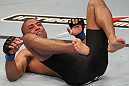 "BELO HORIZONTE, BRAZIL - JUNE 23:   Sergio ""Serginho"" Moraes lies on the canvas after being knocked down by Cezar ""Mutante"" Ferreira during their UFC 147 middleweight bout at Estadio Jornalista Felipe Drummond on June 23, 2012 in Belo Horizonte, Brazil.  (Photo by Josh Hedges/Zuffa LLC/Zuffa LLC via Getty Images)"