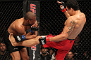 "BELO HORIZONTE, BRAZIL - JUNE 23:   (R-L) Cezar ""Mutante"" Ferreira kicks Sergio ""Serginho"" Moraes during their UFC 147 middleweight bout at Estádio Jornalista Felipe Drummond on June 23, 2012 in Belo Horizonte, Brazil.  (Photo by Josh Hedges/Zuffa LLC/Zuffa LLC via Getty Images)"
