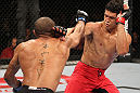 "BELO HORIZONTE, BRAZIL - JUNE 23:   (L-R) Sergio ""Serginho"" Moraes punches Cezar ""Mutante"" Ferreira during their UFC 147 middleweight bout at Estádio Jornalista Felipe Drummond on June 23, 2012 in Belo Horizonte, Brazil.  (Photo by Josh Hedges/Zuffa LLC/Zuffa LLC via Getty Images)"