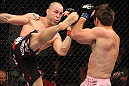 BELO HORIZONTE, BRAZIL - JUNE 23:   (L-R) Wanderlei Silva kicks Rich Franklin during their UFC 147 catchweight bout at Estadio Jornalista Felipe Drummond on June 23, 2012 in Belo Horizonte, Brazil.  (Photo by Josh Hedges/Zuffa LLC/Zuffa LLC via Getty Images)