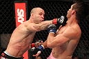BELO HORIZONTE, BRAZIL - JUNE 23:   (L-R) Wanderlei Silva lands a punch that drops Rich Franklin during their UFC 147 catchweight bout at Estadio Jornalista Felipe Drummond on June 23, 2012 in Belo Horizonte, Brazil.  (Photo by Josh Hedges/Zuffa LLC/Zuffa LLC via Getty Images)
