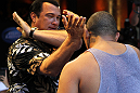 LAS VEGAS, NV - JULY 5:   Martial arts actor Steven Seagal demonstrates a technique during the UFC 148 Open Workouts inside XS nightclub at the Encore on July 5, 2012 in Las Vegas, Nevada.  (Photo by Josh Hedges/Zuffa LLC/Zuffa LLC via Getty Images)