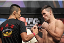 LAS VEGAS, NV - JULY 6:   (L-R) Opponents Dong Hyun Kim and Demian Maia face off during the UFC 148 Weigh In at the Mandalay Bay Events Center on July 6, 2012 in Las Vegas, Nevada.  (Photo by Josh Hedges/Zuffa LLC/Zuffa LLC via Getty Images)