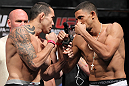 LAS VEGAS, NV - JULY 6:   (L-R) Opponents Rafaello Oliveira and Yoislandy Izquierdo face off during the UFC 148 Weigh In at the Mandalay Bay Events Center on July 6, 2012 in Las Vegas, Nevada.  (Photo by Josh Hedges/Zuffa LLC/Zuffa LLC via Getty Images)