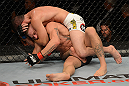 LAS VEGAS, NV - JULY 7:   Shane Roller (top) attempts to submit John Alessio during their lightweight bout at UFC 148 inside MGM Grand Garden Arena on July 7, 2012 in Las Vegas, Nevada.  (Photo by Donald Miralle/Zuffa LLC/Zuffa LLC via Getty Images)  *** Local Caption *** John Alessio; Shane Roller