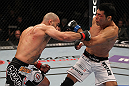 LAS VEGAS, NV - JULY 7:   (L-R) Costa Philippou punches Riki Fukuda during their middleweight bout at UFC 148 inside MGM Grand Garden Arena on July 7, 2012 in Las Vegas, Nevada.  (Photo by Josh Hedges/Zuffa LLC/Zuffa LLC via Getty Images)  *** Local Caption *** Constantinos Philippou; Riki Fukuda