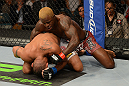 LAS VEGAS, NV - JULY 7:   Melvin Guillard (top) punches Fabricio Camoes during their lightweight bout at UFC 148 inside MGM Grand Garden Arena on July 7, 2012 in Las Vegas, Nevada.  (Photo by Donald Miralle/Zuffa LLC/Zuffa LLC via Getty Images)  *** Local Caption *** Melvin Guillard; Fabricio Camoes