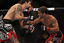 LAS VEGAS, NV - JULY 7:   (R-L) Chad Mendes punches Cody McKenzie during their featherweight bout at UFC 148 inside MGM Grand Garden Arena on July 7, 2012 in Las Vegas, Nevada.  (Photo by Josh Hedges/Zuffa LLC/Zuffa LLC via Getty Images)  *** Local Caption *** Chad Mendes; Cody McKenzie