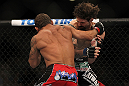 LAS VEGAS, NV - JULY 7:   (L-R) Chad Mendes punches Cody McKenzie during their featherweight bout at UFC 148 inside MGM Grand Garden Arena on July 7, 2012 in Las Vegas, Nevada. (Photo by Josh Hedges/Zuffa LLC/Zuffa LLC via Getty Images)  *** Local Caption *** Chad Mendes; Cody McKenzie
