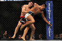 LAS VEGAS, NV - JULY 7:   Demian Maia (left) wrestles Dong Hyun Kim during their welterweight bout at UFC 148 inside MGM Grand Garden Arena on July 7, 2012 in Las Vegas, Nevada.  (Photo by Josh Hedges/Zuffa LLC/Zuffa LLC via Getty Images)  *** Local Caption *** Demian Maia; Dong Hyun Kim