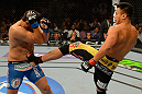 LAS VEGAS, NV - JULY 7:   (R-L) Cung Le kicks Patrick Cote during their middleweight bout at UFC 148 inside MGM Grand Garden Arena on July 7, 2012 in Las Vegas, Nevada.  (Photo by Donald Miralle/Zuffa LLC/Zuffa LLC via Getty Images)  *** Local Caption *** Cung Le; Patrick Cote