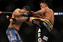 LAS VEGAS, NV - JULY 7:   (R-L) Cung Le kicks Patrick Cote during their middleweight bout at UFC 148 inside MGM Grand Garden Arena on July 7, 2012 in Las Vegas, Nevada.  (Photo by Josh Hedges/Zuffa LLC/Zuffa LLC via Getty Images)  *** Local Caption *** Cung Le; Patrick Cote