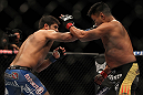 LAS VEGAS, NV - JULY 7:   (L-R) Patrick Cote punches Cung Le during their middleweight bout at UFC 148 inside MGM Grand Garden Arena on July 7, 2012 in Las Vegas, Nevada.  (Photo by Josh Hedges/Zuffa LLC/Zuffa LLC via Getty Images)  *** Local Caption *** Cung Le; Patrick Cote