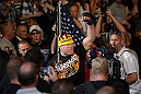 LAS VEGAS, NV - JULY 7:   Tito Ortiz walks to the Octagon before his light heavyweight bout with Forrest Griffin at UFC 148 inside MGM Grand Garden Arena on July 7, 2012 in Las Vegas, Nevada.  (Photo by Donald Miralle/Zuffa LLC/Zuffa LLC via Getty Images)  *** Local Caption *** Tito Ortiz