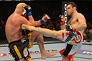 LAS VEGAS, NV - JULY 7:   (R-L) Forrest Griffin kicks Tito Ortiz during their light heavyweight bout at UFC 148 inside MGM Grand Garden Arena on July 7, 2012 in Las Vegas, Nevada.  (Photo by Donald Miralle/Zuffa LLC/Zuffa LLC via Getty Images)  *** Local Caption *** Tito Ortiz; Forrest Griffin