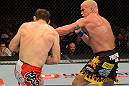 LAS VEGAS, NV - JULY 7:   (R-L) Tito Ortiz punches Forrest Griffin during their light heavyweight bout at UFC 148 inside MGM Grand Garden Arena on July 7, 2012 in Las Vegas, Nevada.  (Photo by Donald Miralle/Zuffa LLC/Zuffa LLC via Getty Images)  *** Local Caption *** Tito Ortiz; Forrest Griffin