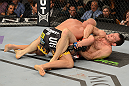LAS VEGAS, NV - JULY 7:   (R-L) Forrest Griffin attempts to submit Tito Ortiz during their light heavyweight bout at UFC 148 inside MGM Grand Garden Arena on July 7, 2012 in Las Vegas, Nevada.  (Photo by Donald Miralle/Zuffa LLC/Zuffa LLC via Getty Images)  *** Local Caption *** Tito Ortiz; Forrest Griffin