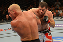 LAS VEGAS, NV - JULY 7:   (R-L) Forrest Griffin punches Tito Ortiz during their light heavyweight bout at UFC 148 inside MGM Grand Garden Arena on July 7, 2012 in Las Vegas, Nevada.  (Photo by Donald Miralle/Zuffa LLC/Zuffa LLC via Getty Images)  *** Local Caption *** Tito Ortiz; Forrest Griffin