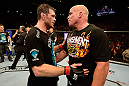 LAS VEGAS, NV - JULY 7:   (L-R) Forrest Griffin and Tito Ortiz congratulate one another after their light heavyweight bout at UFC 148 inside MGM Grand Garden Arena on July 7, 2012 in Las Vegas, Nevada.  (Photo by Donald Miralle/Zuffa LLC/Zuffa LLC via Getty Images)  *** Local Caption *** Tito Ortiz; Forrest Griffin
