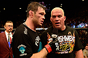 LAS VEGAS, NV - JULY 7:   (L-R) Forrest Griffin interviews Tito Ortiz after their light heavyweight bout at UFC 148 inside MGM Grand Garden Arena on July 7, 2012 in Las Vegas, Nevada.  (Photo by Donald Miralle/Zuffa LLC/Zuffa LLC via Getty Images)  *** Local Caption *** Tito Ortiz; Forrest Griffin