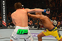 LAS VEGAS, NV - JULY 7:   (R-L) Anderson Silva punches Chael Sonnen during their UFC middleweight championship bout at UFC 148 inside MGM Grand Garden Arena on July 7, 2012 in Las Vegas, Nevada.  (Photo by Donald Miralle/Zuffa LLC/Zuffa LLC via Getty Images)  *** Local Caption *** Anderson Silva; Chael Sonnen