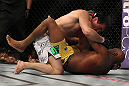 LAS VEGAS, NV - JULY 7:   Chael Sonnen (top) punches Anderson Silva during their UFC middleweight championship bout at UFC 148 inside MGM Grand Garden Arena on July 7, 2012 in Las Vegas, Nevada.  (Photo by Josh Hedges/Zuffa LLC/Zuffa LLC via Getty Images)  *** Local Caption *** Anderson Silva; Chael Sonnen