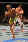 LAS VEGAS, NV - JULY 7:   (L-R) Anderson Silva kicks Chael Sonnen during their UFC middleweight championship bout at UFC 148 inside MGM Grand Garden Arena on July 7, 2012 in Las Vegas, Nevada.  (Photo by Donald Miralle/Zuffa LLC/Zuffa LLC via Getty Images)  *** Local Caption *** Anderson Silva; Chael Sonnen
