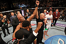LAS VEGAS, NV - JULY 7:   Anderson Silva (left) reacts to being declared the winner in his fight against Chael Sonnen (white shirt, right) after their UFC middleweight championship bout at UFC 148 inside MGM Grand Garden Arena on July 7, 2012 in Las Vegas, Nevada.  (Photo by Josh Hedges/Zuffa LLC/Zuffa LLC via Getty Images)  *** Local Caption *** Anderson Silva; Chael Sonnen