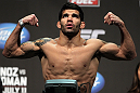 SAN JOSE, CA - JULY 10:   Raphael Assuncao makes weight during the UFC on Fuel TV weigh in at HP Pavilion on July 10, 2012 in San Jose, California.  (Photo by Josh Hedges/Zuffa LLC/Zuffa LLC via Getty Images)