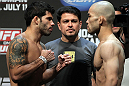 SAN JOSE, CA - JULY 10:   (L-R) Opponents Raphael Assuncao and Issei Tamura face off during the UFC on Fuel TV weigh in at HP Pavilion on July 10, 2012 in San Jose, California.  (Photo by Josh Hedges/Zuffa LLC/Zuffa LLC via Getty Images)