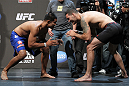 SAN JOSE, CA - JULY 10:   (L-R) Opponents Mark Munoz and Chris Weidman face off after making weight during the UFC on Fuel TV weigh in at HP Pavilion on July 10, 2012 in San Jose, California.  (Photo by Josh Hedges/Zuffa LLC/Zuffa LLC via Getty Images)