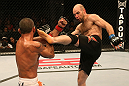SAN JOSE, CA - JULY 11:   (R-L) Dan Stittgen kicks Marcelo Guimaraes during their welterweight bout at HP Pavilion on July 11, 2012 in San Jose, California.  (Photo by Ezra Shaw/Zuffa LLC/Zuffa LLC via Getty Images)  *** Local Caption *** Marcelo Guimaraes; Dan Stittgen