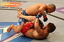 SAN JOSE, CA - JULY 11:   Chris Cariaso (top) punches Josh Ferguson during their flyweight bout at HP Pavilion on July 11, 2012 in San Jose, California.  (Photo by Ezra Shaw/Zuffa LLC/Zuffa LLC via Getty Images)  *** Local Caption *** Chris Cariaso; Josh Ferguson
