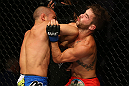 SAN JOSE, CA - JULY 11:   (L-R) Chris Cariaso elbows Josh Ferguson during their flyweight bout at HP Pavilion on July 11, 2012 in San Jose, California.  (Photo by Ezra Shaw/Zuffa LLC/Zuffa LLC via Getty Images)  *** Local Caption *** Chris Cariaso; Josh Ferguson