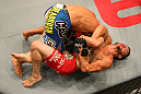 SAN JOSE, CA - JULY 11:   Josh Ferguson (red shorts) attempts to submit Chris Cariaso during their flyweight bout at HP Pavilion on July 11, 2012 in San Jose, California.  (Photo by Ezra Shaw/Zuffa LLC/Zuffa LLC via Getty Images)  *** Local Caption *** Chris Cariaso; Josh Ferguson