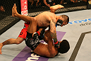 SAN JOSE, CA - JULY 11:   Damacio Page (top) punches Alex Caceres during their bantamweight bout at HP Pavilion on July 11, 2012 in San Jose, California.  (Photo by Ezra Shaw/Zuffa LLC/Zuffa LLC via Getty Images)  *** Local Caption *** Damacio Page; Alex Caceres
