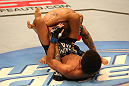 SAN JOSE, CA - JULY 11:   Alex Caceres (bottom) attempts to submit Damacio Page during their bantamweight bout at HP Pavilion on July 11, 2012 in San Jose, California.  (Photo by Ezra Shaw/Zuffa LLC/Zuffa LLC via Getty Images)  *** Local Caption *** Damacio Page; Alex Caceres