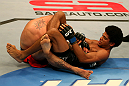 SAN JOSE, CA - JULY 11:   Alex Caceres (right) attempts to submit Damacio Page during their bantamweight bout at HP Pavilion on July 11, 2012 in San Jose, California.  (Photo by Ezra Shaw/Zuffa LLC/Zuffa LLC via Getty Images)  *** Local Caption *** Damacio Page; Alex Caceres