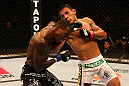 SAN JOSE, CA - JULY 11:   (R-L) Rafael dos Anjos punches Anthony Njokuani during their lightweight bout at HP Pavilion on July 11, 2012 in San Jose, California.  (Photo by Ezra Shaw/Zuffa LLC/Zuffa LLC via Getty Images)  *** Local Caption *** Rafael Dos Anjos; Anthony Njokuani