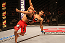 SAN JOSE, CA - JULY 11:   TJ Dillashaw (red shorts) lifts Vaughan Lee into the air during their bantamweight bout at HP Pavilion on July 11, 2012 in San Jose, California.  (Photo by Ezra Shaw/Zuffa LLC/Zuffa LLC via Getty Images)  *** Local Caption *** T.J. Dillashaw; Vaughn Lee