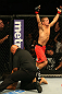 SAN JOSE, CA - JULY 11:   TJ Dillashaw (red shorts) reacts to his submission victory over Vaughan Lee after their bantamweight bout at HP Pavilion on July 11, 2012 in San Jose, California.  (Photo by Ezra Shaw/Zuffa LLC/Zuffa LLC via Getty Images)  *** Local Caption *** T.J. Dillashaw