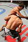 SAN JOSE, CA - JULY 11:   Aaron Simpson (top) punches Kenny Robertson during their welterweight bout at HP Pavilion on July 11, 2012 in San Jose, California.  (Photo by Ezra Shaw/Zuffa LLC/Zuffa LLC via Getty Images)  *** Local Caption *** Aaron Simpson; Kenny Robertson