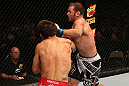 SAN JOSE, CA - JULY 11:   Kenny Robertson (right) punches Aaron Simpson during their welterweight bout at HP Pavilion on July 11, 2012 in San Jose, California.  (Photo by Ezra Shaw/Zuffa LLC/Zuffa LLC via Getty Images)  *** Local Caption *** Aaron Simpson; Kenny Robertson