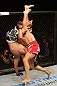 SAN JOSE, CA - JULY 11:   Aaron Simpson (red shorts) slams Kenny Robertson during their welterweight bout at HP Pavilion on July 11, 2012 in San Jose, California.  (Photo by Ezra Shaw/Zuffa LLC/Zuffa LLC via Getty Images)  *** Local Caption *** Aaron Simpson; Kenny Robertson