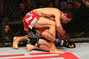 SAN JOSE, CA - JULY 11:   Aaron Simpson (red shorts) punches Kenny Robertson during their welterweight bout at HP Pavilion on July 11, 2012 in San Jose, California.  (Photo by Ezra Shaw/Zuffa LLC/Zuffa LLC via Getty Images)  *** Local Caption *** Aaron Simpson; Kenny Robertson