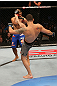 SAN JOSE, CA - JULY 11:   Chris Weidman (grey shorts) kicks Mark Munoz during their middleweight bout at HP Pavilion on July 11, 2012 in San Jose, California.  (Photo by Ezra Shaw/Zuffa LLC/Zuffa LLC via Getty Images)  *** Local Caption *** Mark Munoz; Chris Weidman