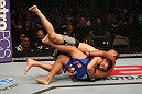 SAN JOSE, CA - JULY 11:   Chris Weidman (grey shorts) takes down Mark Munoz during their middleweight bout at HP Pavilion on July 11, 2012 in San Jose, California.  (Photo by Ezra Shaw/Zuffa LLC/Zuffa LLC via Getty Images)  *** Local Caption *** Mark Munoz; Chris Weidman
