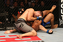 SAN JOSE, CA - JULY 11:   Chris Weidman (grey shorts) elbows Mark Munoz during their middleweight bout at HP Pavilion on July 11, 2012 in San Jose, California.  (Photo by Ezra Shaw/Zuffa LLC/Zuffa LLC via Getty Images)  *** Local Caption *** Mark Munoz; Chris Weidman