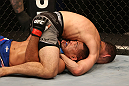 SAN JOSE, CA - JULY 11:   Chris Weidman (grey shorts) attempts to submit Mark Munoz during their middleweight bout at HP Pavilion on July 11, 2012 in San Jose, California.  (Photo by Ezra Shaw/Zuffa LLC/Zuffa LLC via Getty Images)  *** Local Caption *** Mark Munoz; Chris Weidman
